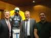 """Reutlingens BM Alexander Kreher und MD Hubert Wicker mit Matthias Werz und dem """"Integrated Avalanche System"""" – dem Lawinenschutzrucksack"""